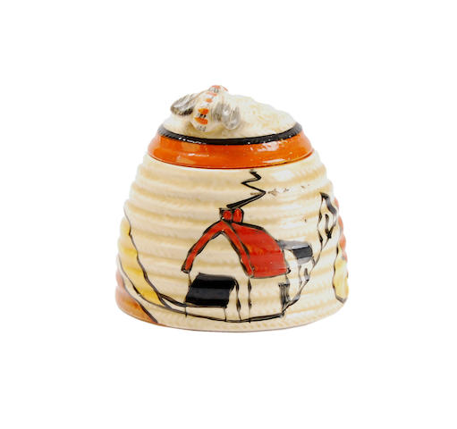 A Clarice Cliff 'Red Roof House' pattern honey pot and cover