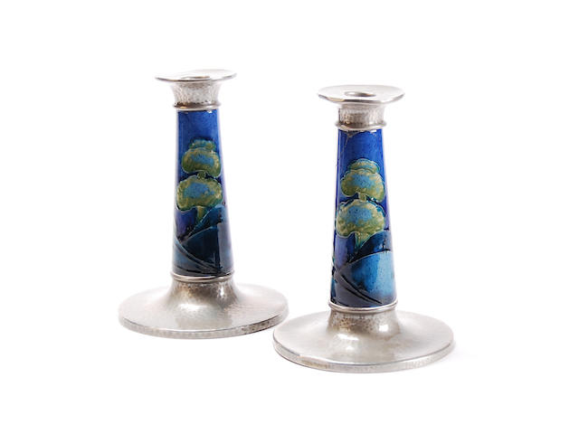 A pair of Moorcroft 'Midnight Blue' tudric pewter mounted candlesticks for Liberty & Co. Circa 1920