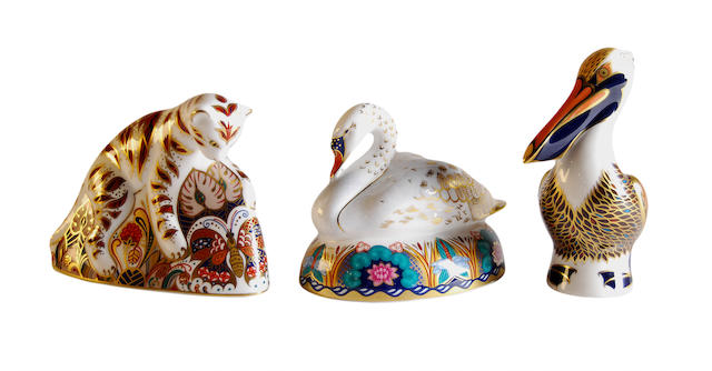 3 royal crown derby paperweights Swan, tiger cub, pelican.