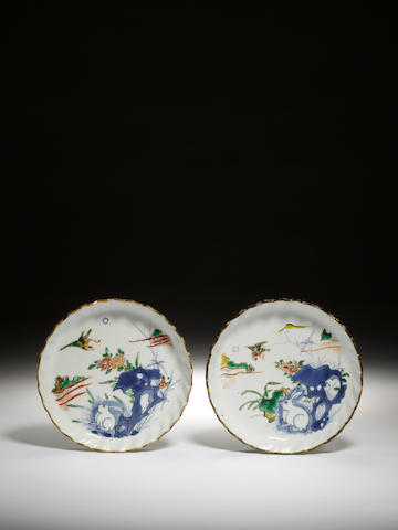 A rare pair of blue and white and enamelled moulded dishes  Circa 1620-1645