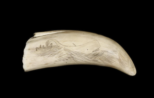 A 19th century decorated whale's tooth, 7in (18cm) long