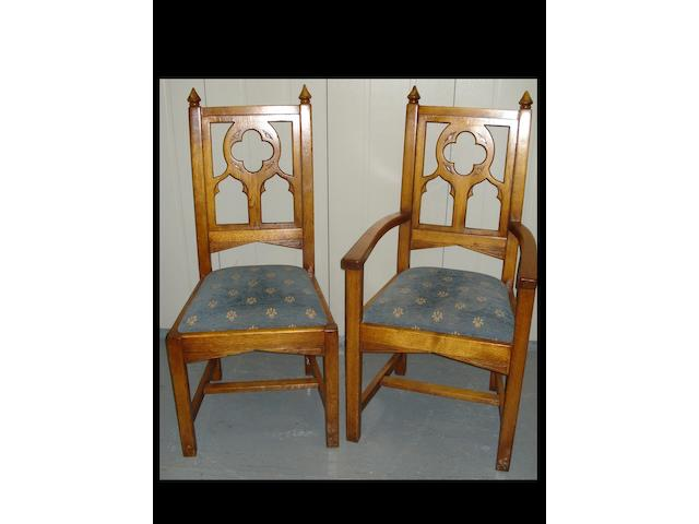 A set of eight 20th century carved oak dining chairs