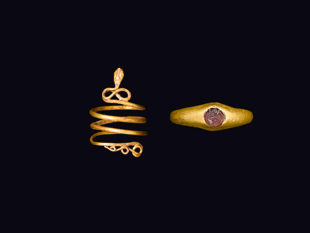 A Roman gold and garnet intaglio ring, and a gold snake ring (possibly not ancient)
