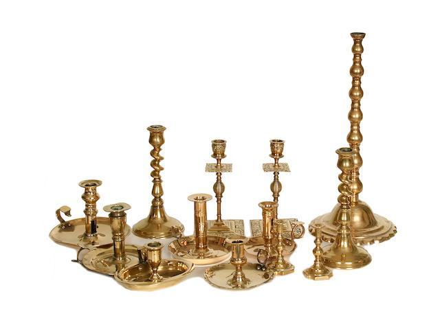 A collection of thirteen various brass candlesticks and chambersticks