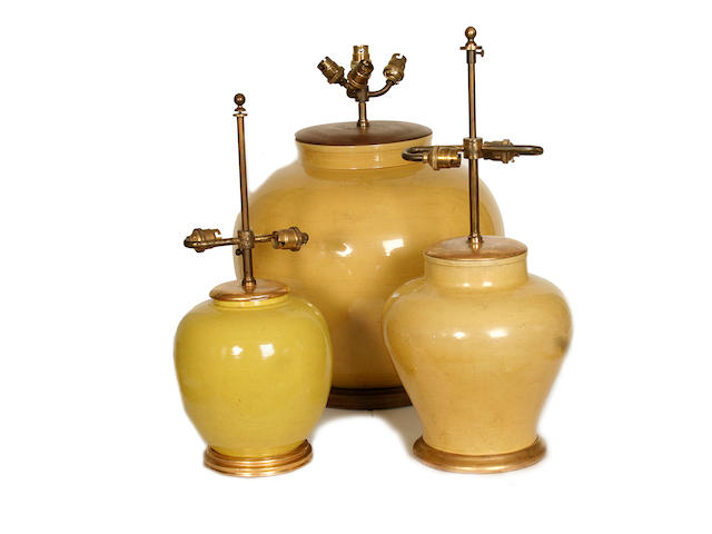 A collection of three various yellow glazed ceramic lamp bases
