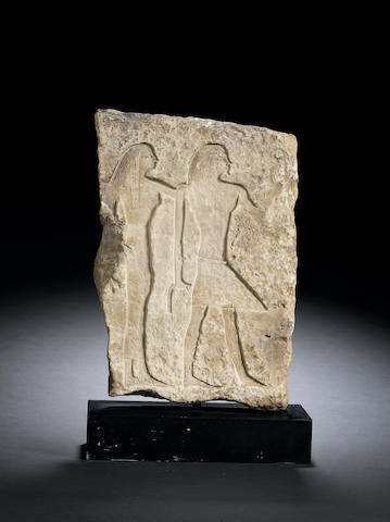 An Egyptian limestone relief fragment 1st Intermediate Period, circa 2181-2040 B.C.