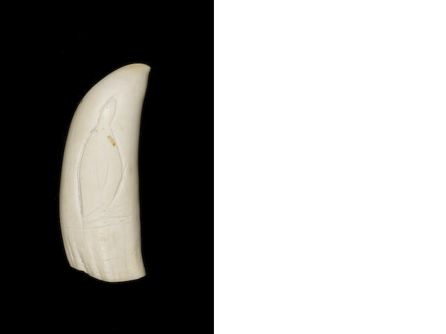 An early 20thC carved whale's tooth, 6in(15cm)long