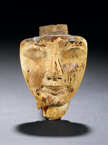 An Egyptian wood sarcophagus mask