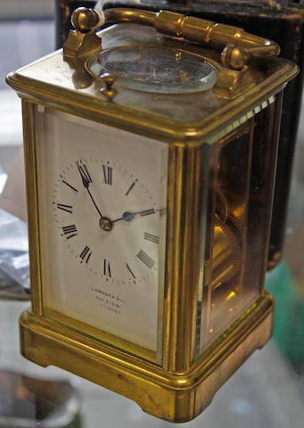 A cased French brass carriage timepiece 2