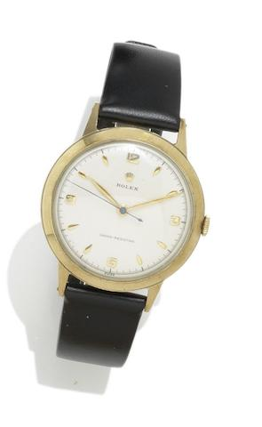 Rolex. A 9ct gold manual wind wristwatch Reference 13874, Case Number 421242, Hallmarked Birmingham 1952