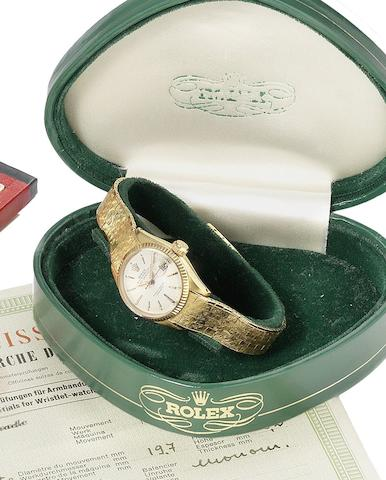 Rolex. A lady's 18ct gold automatic calendar bracelet watch together with original fitted box and papersDatejust, Ref:6517, Serial number 963953, Sold 18th of May 1961