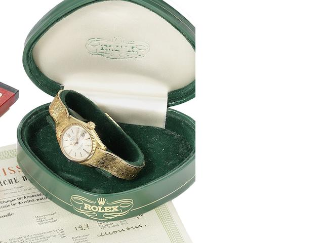 Rolex. A lady's 18ct gold automatic calendar bracelet watch together with original fitted box and papers Datejust, Ref:6517, Serial number 963953, Sold 18th of May 1961