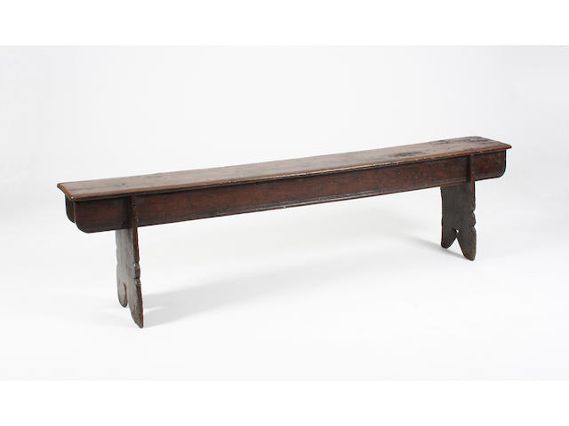 A Henry VIII oak boarded bench, circa 1520