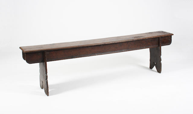 An exceptionally rare early Elizabethan oak boarded bench