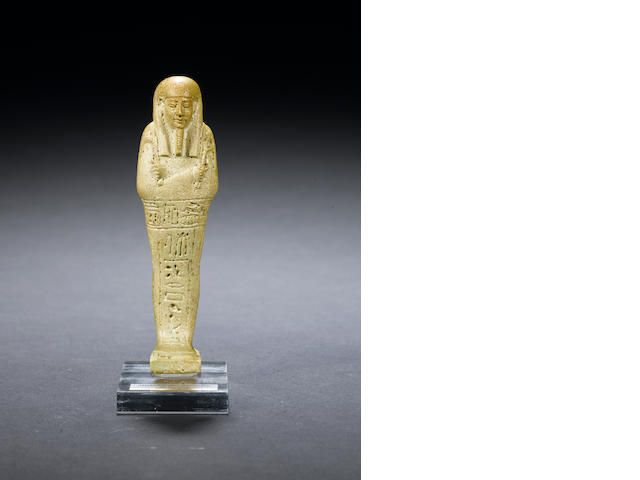 An Egyptian green glazed composition shabti for Ka-Nefer