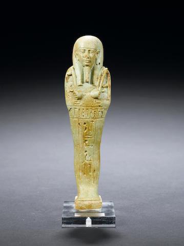 an Egyptian glazed composition shabti for Horudja