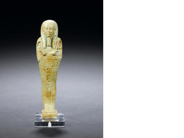 an Egyptian glazed composition shabti for Horudja
