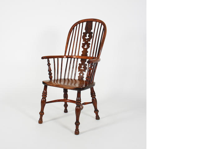 A Victorian yew-wood high-backed Windsor chair