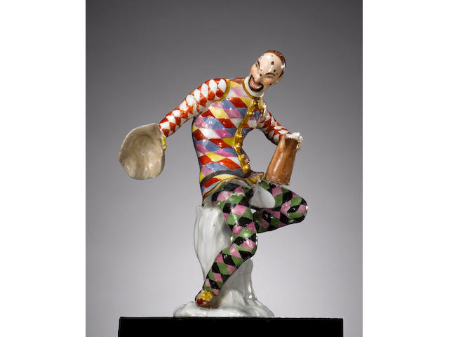 A Meissen figure of the dancing Harlequin with jug circa 1740