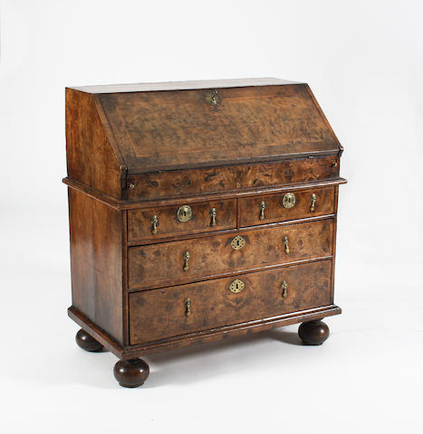 A Queen Anne figured walnut and double-featherbanded bureau, circa 1705