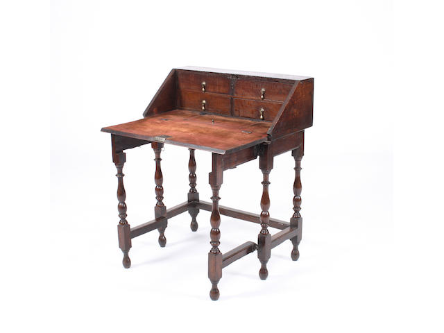 A Queen Anne oak bureau table, circa 1705