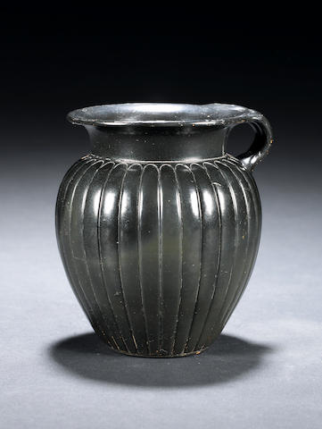 An Attic black glazed mug with double handles