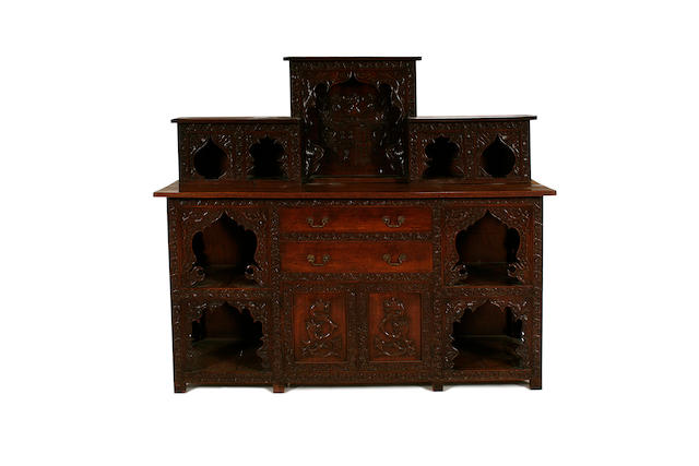 A late 19th century Anglo Indian carved padouk side cabinet