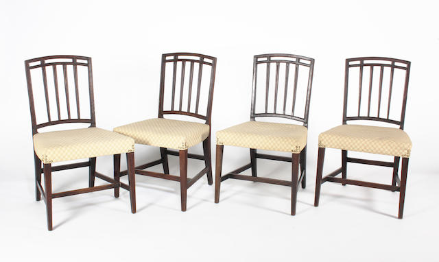 A set of four George III mahogany standard chairs