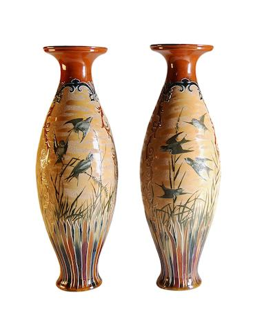 Lambeth A large and exceptional pair of Florence Barlow Doulton Lambeth vases, Circa 1880