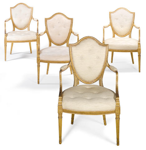 A set of four George III carved giltwood open armchairs attributed to Gillows