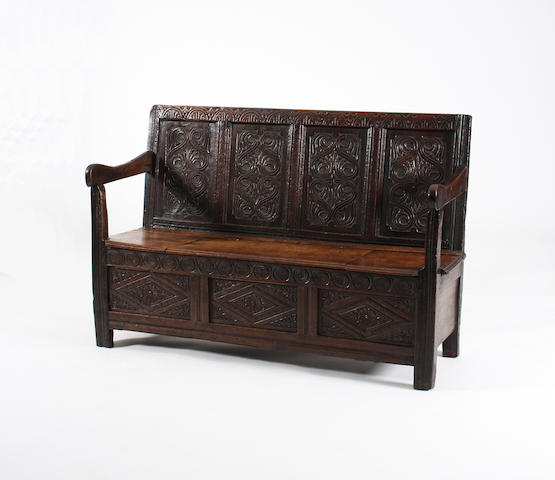 An oak box settle, circa 1700