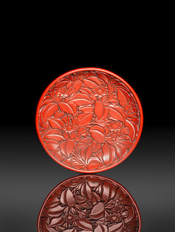 A very fine cinnabar lacquer circular carved 'oleander' dish Yongle