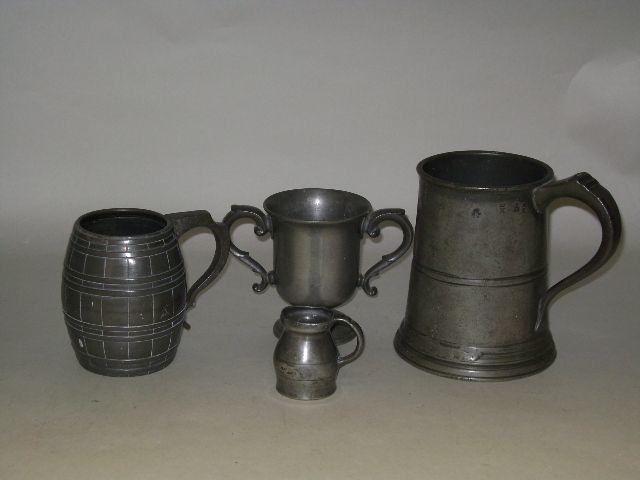 A 19th century straight-sided quart mug