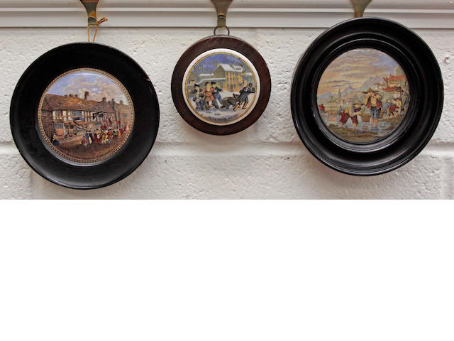 A Prattware pot lid 'Alas Poor Bruin', framed; together with two other framed pot lids, 'Shakespeare's House' and 'Transplanting Rice' and another pot lid 'Embarking for the East'.(4)