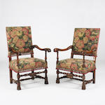 A near pair of late 17th Century Flemish style walnut open armchairs