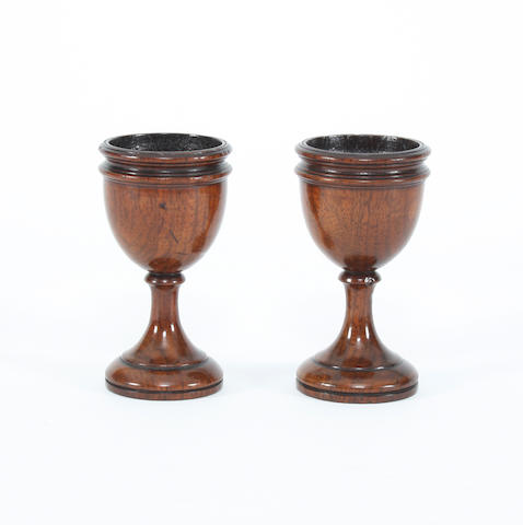 A pair of early 19th Century fruitwood egg cups