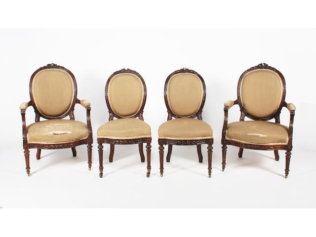 A pair of French late 19th century, Louis XVI style, foliate carved walnut frame, upholstered fauteuil, and a matching pair of side chairs