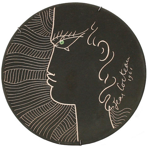 Jean Cocteau (French, 1892-1963) Face in profile against black background 27.5cm (10 3/4in)(diameter)