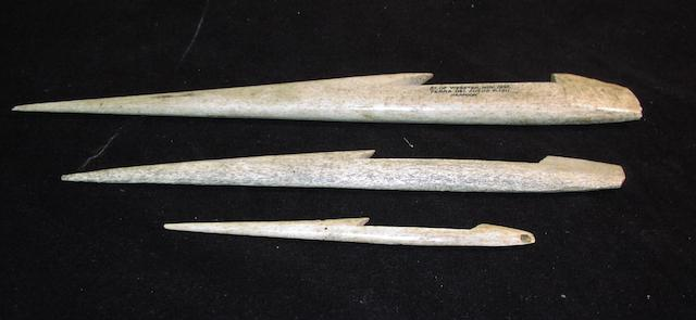 A collection of Inuit bone Harpoon heads,     Between 7-14in(18-36cm)long. 3