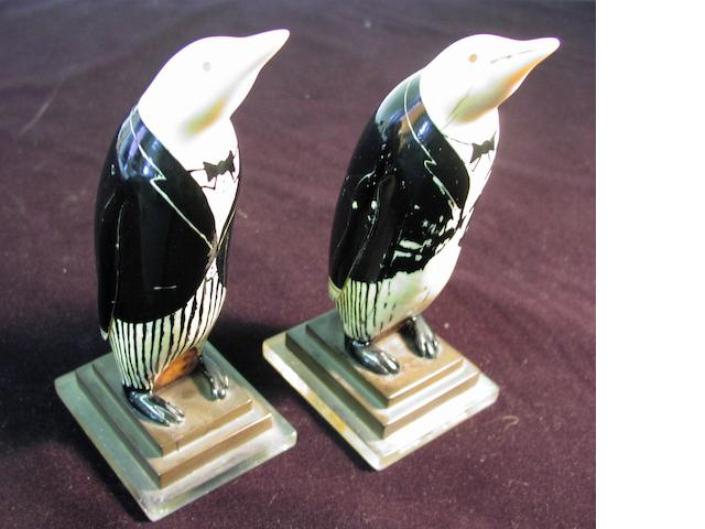 A pair of early 20thC carved whale's teeth, 7in(18cm)high each 2