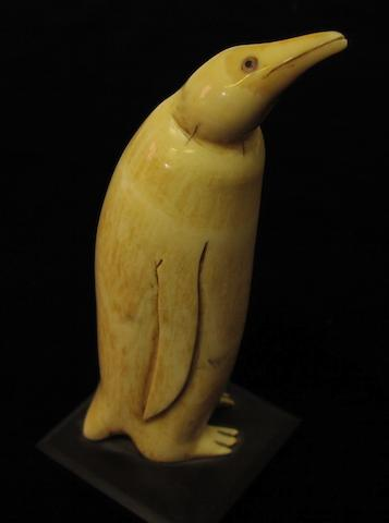 An early 20thC carved whale's tooth, 7in(18cm)high