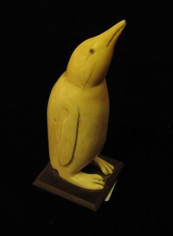 A carved whale's tooth, 5.3in (13.5cm) high