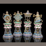 A rare set of eight cloisonne enamel and enameled altar symbols