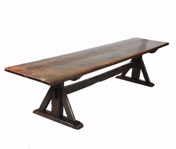 A 17th Century and later oak trestle table