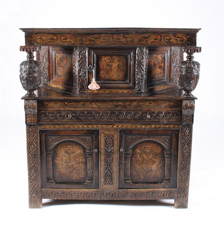 A mid-17th Century oak and marquetry court cupboard