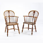 A harlequin set of eight Victorian ash and elm Windsor chairs, to include one high back example   (8)