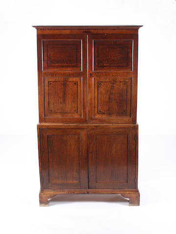 A George III oak and line inlaid livery cabinet