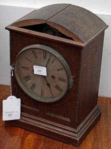 A late 19th Century oak cased mantel clock