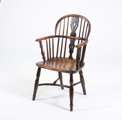 A Victorian yew and elm low-back Windsor chair