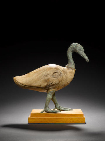 An Egyptian wood and bronze goose